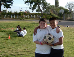 Students holding soccer ball